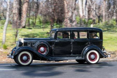 Adelaide, Australia - September 25, 2016: Vintage 1933 Chrysler CT Sedan driving on country roads near the town of Birdwood, South Australia. Editorial