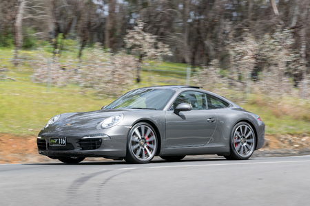 Adelaide, Australia - September 25, 2016:  Luxury Porsche driving on country roads near the town of Birdwood, South Australia. Editorial