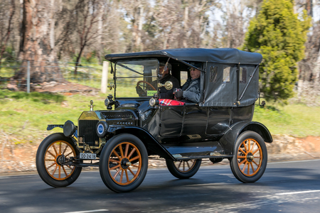 Adelaide, Australia - September 25, 2016: Vintage 1915 Ford T Tourer driving on country roads near the town of Birdwood, South Australia.