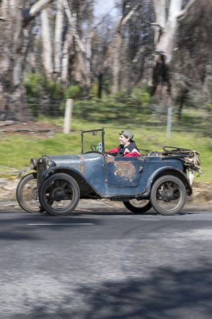 Adelaide, Australia - September 25, 2016: Vintage 1928 Austin 7 Tourer driving on country roads near the town of Birdwood, South Australia. Editorial