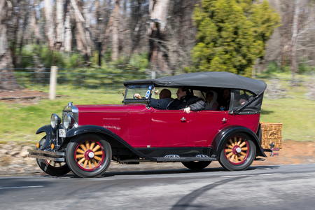 Adelaide, Australia - September 25, 2016: Vintage 1929 Chevrolet International Tourer driving on country roads near the town of Birdwood, South Australia. Editorial