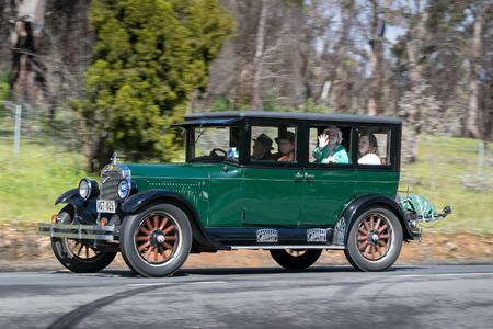 Adelaide, Australia - September 25, 2016: Vintage 1926 Oldsmobile E Series Sedan driving on country roads near the town of Birdwood, South Australia.