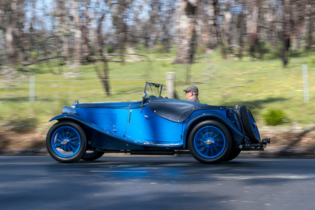 Adelaide, Australia - September 25, 2016: Vintage 1934 MG ND Roadster  driving on country roads near the town of Birdwood, South Australia.