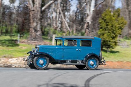 Adelaide, Australia - September 25, 2016: Vintage 1929 Chevrolet AC International Sedan driving on country roads near the town of Birdwood, South Australia.
