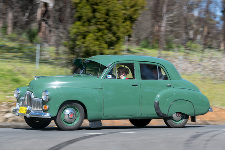 Adelaide, Australia - September 25, 2016: Vintage 1953 Holden FX driving on country roads near the town of Birdwood, South Australia.