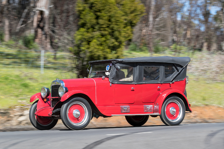 Adelaide, Australia - September 25, 2016: Vintage 1924 Maxwell Good Tourer driving on country roads near the town of Birdwood, South Australia.
