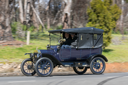 Adelaide, Australia - September 25, 2016: Vintage 1915 Ford Model T Tourer driving on country roads near the town of Birdwood, South Australia.