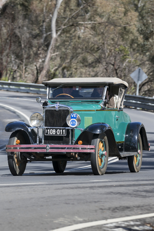 Adelaide, Australia - September 25, 2016: Vintage 1929 Chevrolet 1929 AC Roadster driving on country roads near the town of Birdwood, South Australia.
