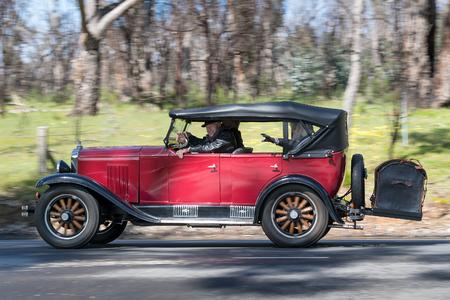 Adelaide, Australia - September 25, 2016: Vintage 1929 Chevrolet Tourer Sedan driving on country roads near the town of Birdwood, South Australia.