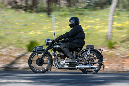 Adelaide, Australia - September 25, 2016: Vintage 1951 Triumph Speed Twin Motorcycle on country roads near the town of Birdwood, South Australia.