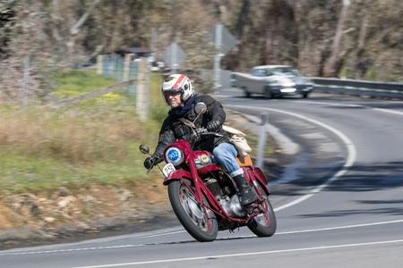 Adelaide, Australia - September 25, 2016: Vintage 1956 Ariel BV Motorcycle on country roads near the town of Birdwood, South Australia. Editorial