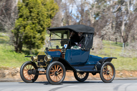 Adelaide, Australia - September 25, 2016: Vintage 1913 Ford T Turtle deck driving on country roads near the town of Birdwood, South Australia. Editorial