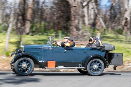 Adelaide, Australia - September 25, 2016: Vintage 1927 Morris Empire Oxford Tourer driving on country roads near the town of Birdwood, South Australia.