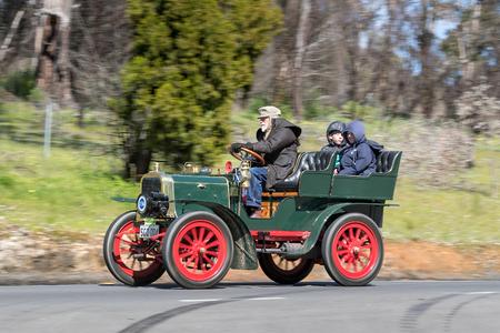 Adelaide, Australia - September 25, 2016: Vintage 1929 Willys Whippet Tourer driving on country roads near the town of Birdwood, South Australia.