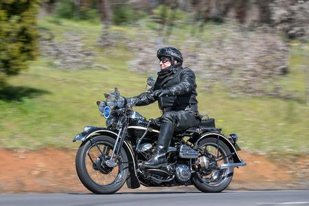 Adelaide, Australia - September 25, 2016: Vintage 1942 Harley Davidson WLA Motorcycle on country roads near the town of Birdwood, South Australia.