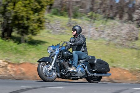 Adelaide, Australia - September 25, 2016: Vintage Harley Davidson Motorcycle on country roads near the town of Birdwood, South Australia.