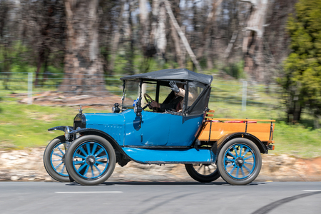 Adelaide, Australia - September 25, 2016: Vintage 1919 Ford Model T Buckboard driving on country roads near the town of Birdwood, South Australia. Editorial