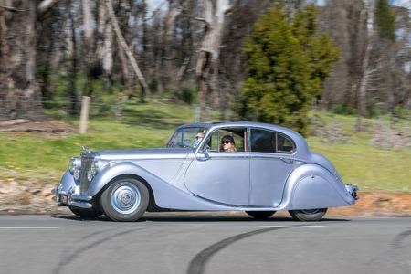 Adelaide, Australia - September 25, 2016: Vintage 1951 Jaguar Mk V Coupe driving on country roads near the town of Birdwood, South Australia.