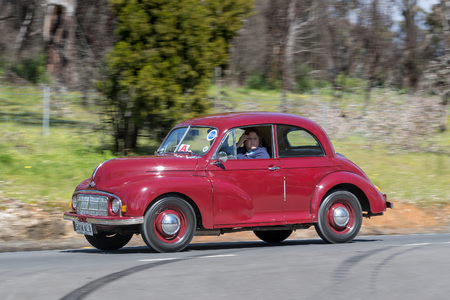 Adelaide, Australia - September 25, 2016: Vintage 1950 Morris Lolite Minor Saloon driving on country roads near the town of Birdwood, South Australia.
