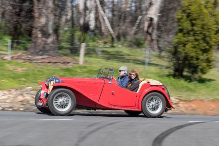 Adelaide, Australia - September 25, 2016: Vintage 1949 MG TC Tourer driving on country roads near the town of Birdwood, South Australia.