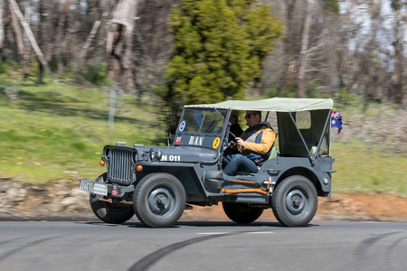 Adelaide, Australia - September 25, 2016: Vintage 1943 Willys GPW Tourer driving on country roads near the town of Birdwood, South Australia. Editorial