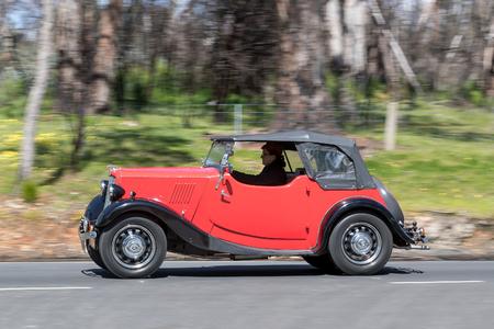 Adelaide, Australia - September 25, 2016: Vintage Car driving on country roads near the town of Birdwood, South Australia.