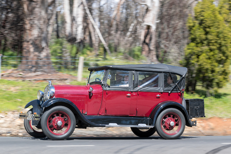 Adelaide, Australia - September 25, 2016: Vintage 1929 Ford A Tourer driving on country roads near the town of Birdwood, South Australia.