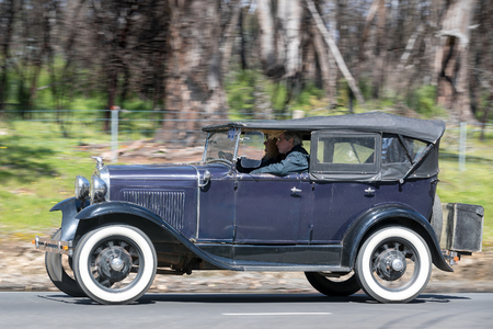 Adelaide, Australia - September 25, 2016: Vintage 1930 Ford Model A Phaeton driving on country roads near the town of Birdwood, South Australia.