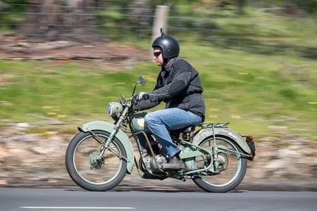 Adelaide, Australia - September 25, 2016: Vintage Motorcycle on country roads near the town of Birdwood, South Australia
