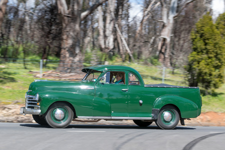 Adelaide, Australia - September 25, 2016: Vintage 1948 Chevrolet Style Master Utility driving on country roads near the town of Birdwood, South Australia.