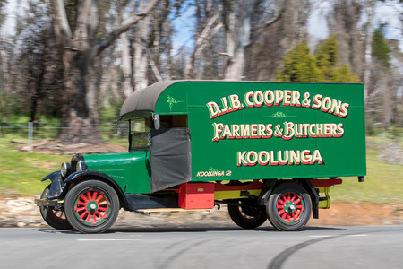 Adelaide, Australia - September 25, 2016: Vintage 1925 Reo SpeedWagon Truck driving on country roads near the town of Birdwood, South Australia.