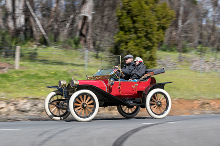 Adelaide, Australia - September 25, 2016: Vintage 1913 Hupmobile 20 Runabout driving on country roads near the town of Birdwood, South Australia.