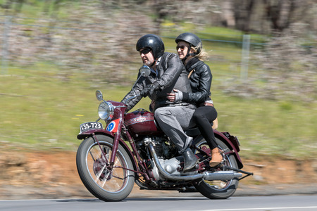 Adelaide, Australia - September 25, 2016: Vintage 1951 Triumph Speed Twin Motorcycle on country roads near the town of Birdwood, South Australia Editorial
