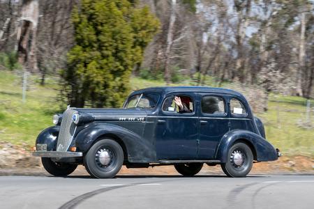 Adelaide, Australia - September 25, 2016: Vintage 1936 Oldsmobile FR Sedan driving on country roads near the town of Birdwood, South Australia. Editorial