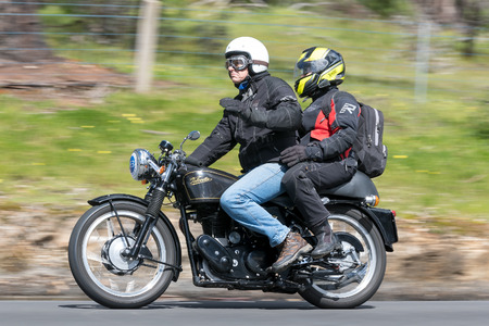 Adelaide, Australia - September 25, 2016: Vintage 1954 Velocette MSS Motorcycle on country roads near the town of Birdwood, South Australia