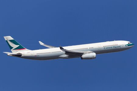 Melbourne, Australia - September 20, 2011: Cathay Pacific Airways Airbus A330-343X B-HLP climbing after takeoff from Melbourne International Airport. Editorial