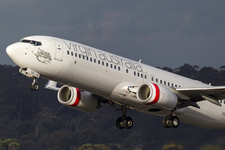 Melbourne, Australia - November 10, 2011: Virgin Australia Airlines Boeing 737-8FE VH-YVA taking off from Melbourne International Airport. Editorial
