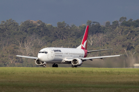 Melbourne, Australia - November 10, 2011: Qantas Boeing 737-476 VH-TJU on the runway at Melbourne International Airport.