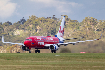 Melbourne, Australia - November 10, 2011: Virgin Blue Airlines Boeing 737-7Q8 VH-VBJ on the runway at Melbourne International Airport.