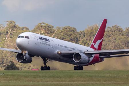 Melbourne, Australia - November 10, 2011: Qantas Boeing 767-336ER VH-ZXF departing Melbourne International Airport.