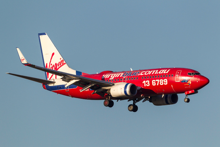 Melbourne, Australia - September 25, 2011: Virgin Blue Airlines Boeing 737-7Q8 VH-VBH on approach to land at Melbourne International Airport. Editorial