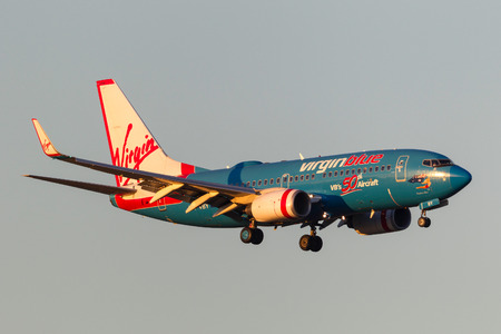 Melbourne, Australia - September 25, 2011: Virgin Blue Airlines 50th aircraft Boeing 737-7FE VH-VBY on approach to land at Melbourne International Airport. Editorial