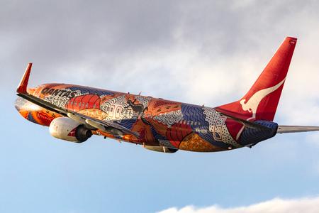 Melbourne, Australia - November 10, 2011: Aboriginal painted Qantas Boeing 737-838 VH-VXB Yananyi Dreaming departing Melbourne International Airport.
