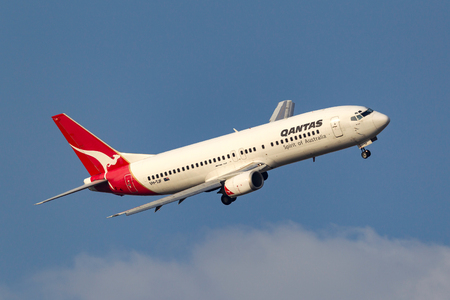 Melbourne, Australia - September 28, 2011: Qantas Boeing 737-476 VH-TJF turning on approach to Melbourne International Airport.