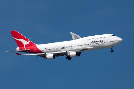 Melbourne, Australia - September 28, 2011: Qantas Boeing 747-438ER VH-OEH turning to land at Melbourne International Airport.