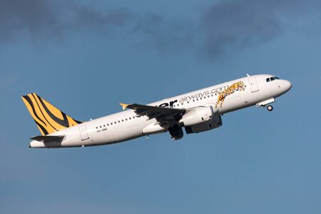 Melbourne, Australia - September 24, 2011: Low cost airline Tiger Airways Airbus A320-232 VH-VND departing Melbourne International Airport.