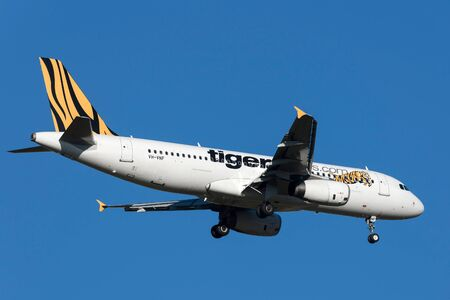 Melbourne, Australia - September 24, 2011: Low cost airline Tiger Airways Airbus A320-232 VH-VNF on approach to land at Melbourne International Airport. Editorial