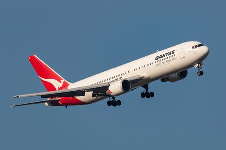 Melbourne, Australia - September 28, 2011: Qantas Boeing 767-338ER VH-OGN turning on approach to land at Melbourne International Airport. Editorial