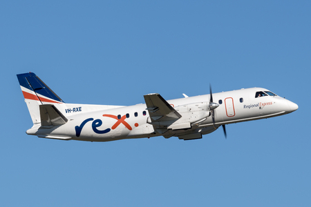 Sydney, Australia - May 5, 2014: REX (Regional Express Airlines) Saab 340 twin engined regional commuter aircraft taking off from Sydney Airport. 写真素材 - 98564565