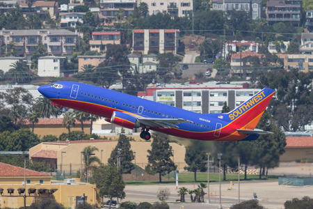San Diego, California, USA - April 28, 2013. Southwest Airlines Boeing 737-3T5 N694SW departing San Diego International Airport. Stock Photo - 98564596